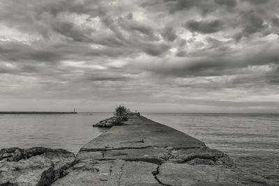 https://imgc.allpostersimages.com/img/posters/cloudscape-over-pier-with-jagged-rocks-b-w_u-L-Q1CQK5V0.jpg?artPerspective=n