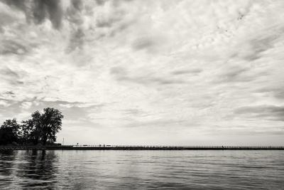 https://imgc.allpostersimages.com/img/posters/cloudscape-over-pier-with-trees-b-w_u-L-Q1CQK2W0.jpg?artPerspective=n