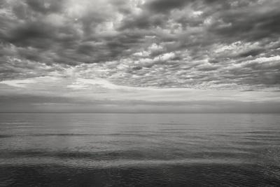https://imgc.allpostersimages.com/img/posters/cloudscape-over-sea-b-w_u-L-Q1CQKWV0.jpg?artPerspective=n
