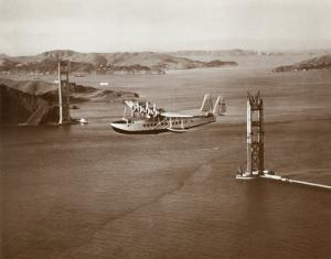 Sikorsky S-42 through the Golden Gate under Construction, San Francisco, 1935 by Clyde Sunderland