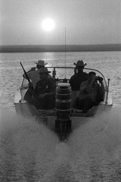 Police Patroling the Waters Between Mexico and the Texas, Us Looking for Marijuana Smugglers by Co Rentmeester