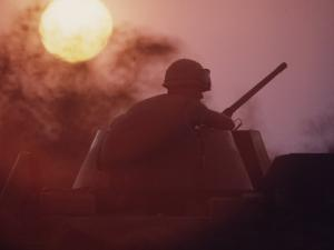 Soldier of the 11th Armored Regiment on a Tank in the Sunset. Vietnam by Co Rentmeester