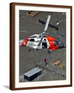 Coast Guard Rescues One from Roof Top of Home, Floodwaters from Hurricane Katrina Cover the Streets