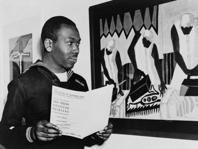Coast Guardsman Jacob Lawrence, with His Paintings at the Institute of Modern Art in Boston in 1945