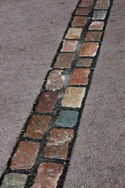 Cobblestones' Line That Marks the Place Where Was the Berlin Wall. Germany