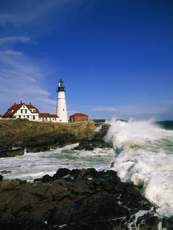 Lighthouse on Coastline by Cody Wood