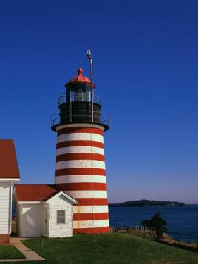 Red and White Striped Lighthouse by Cody Wood