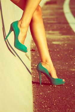 Woman Tan Legs In High Heel Green Shoes Outdoor Shot Summer Day by coka