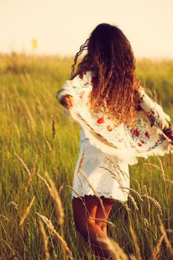 Woman Wearing Boho Style Clothes Run through the Grass, Hot Summer Day, Retro Colors, Motion Blur by coka