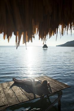 Woman Relaxing on Dock, El Remate, Lago Peten Itza, Guatemala, Central America by Colin Brynn