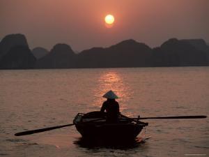 Woman Rowing Woven Skiff, Ha Long Bay (Ha-Long Bay), Unesco World Heritage Site, Vietnam, Indochina by Colin Brynn