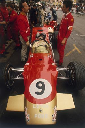 Colin Chapman and a Mechanic in Discussion over Graham Hill's Lotus, Monaco Grand Prix, 1969