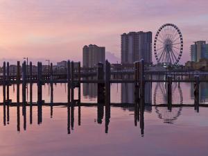 Sunrise on the Pensacola Beach Ferris Wheel on Santa Rosa Sound in Pensacola Beach, Florida by Colin D Young