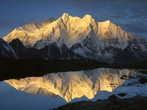 Mt Makalu (8,462m) and Mt Chomolonzo (7,540m) Reflected in Small Lake, Khama Valley, Tibet by Colin Monteath/Minden Pictures
