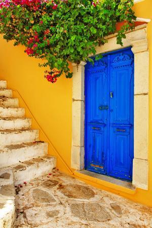 https://imgc.allpostersimages.com/img/posters/colorful-greece-series-symi-island-streets_u-L-Q103WJD0.jpg?p=0