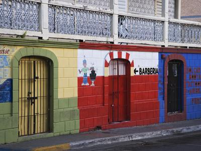 https://imgc.allpostersimages.com/img/posters/colorful-town-shop-fronts-isabela-segunda-vieques-puerto-rico_u-L-P245DG0.jpg?p=0