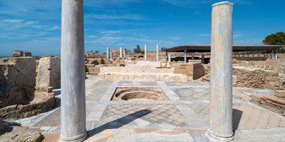 Columns in archaeological site in ancient port city of Caesarea, Israel