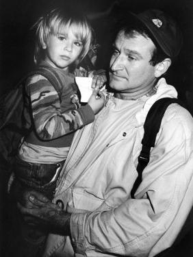 Comedian Robin Williams Carrying Son Zachary