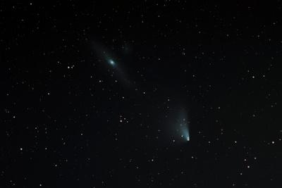 https://imgc.allpostersimages.com/img/posters/comet-panstarrs-near-andromeda-galaxy_u-L-Q105KI20.jpg?artPerspective=n