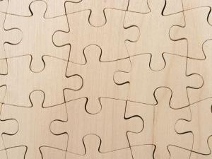 Completed Puzzle Pieces Textured Background