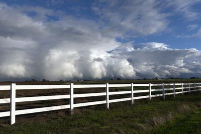https://imgc.allpostersimages.com/img/posters/complex-clouds-form-after-many-inches-of-rain-over-several-days-near-stockton-california_u-L-PWB51G0.jpg?p=0