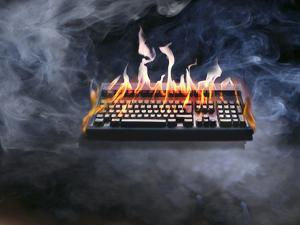 Computer Keyboard on Fire and Smoking