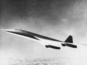 Concorde Slices Through the Sky Above a Snowy Mountain Range