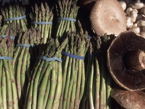 Asparagus and Mushrooms at Stall in Pike Place Market, Seattle, Washington, USA by Connie Ricca