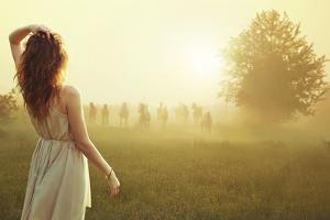 Cute Lady Walking Through the Meadow by conrado