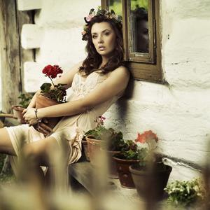 Picture of Young Woman Wearing Wreath of Flowers by conrado