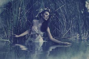 Young Beautiful Woman into the Water by conrado