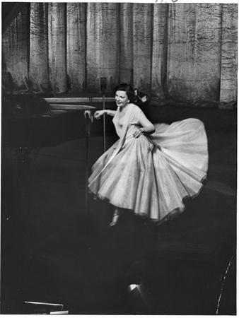 Actress and Singer Judy Garland Twirling Into a Dance Step During a Performance at the Palladium by Cornell Capa