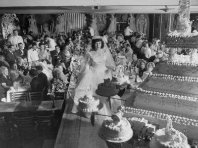 At Palumbo's Cafe, Bride Mrs. Salvatore Cannella Walks Onto Stage, Facing a Revolving Cake Display by Cornell Capa