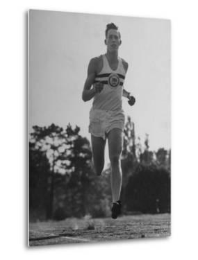 British Track Runner Roger Bannister Running, the First Person to Run a Mile in under Four Minutes by Cornell Capa