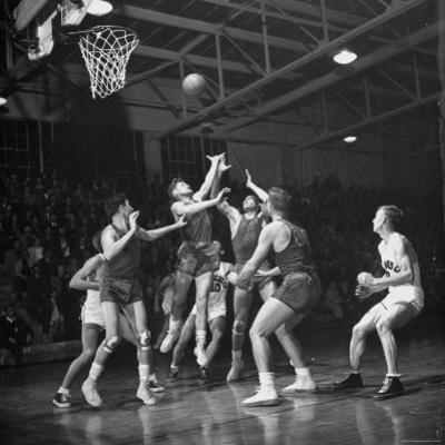 Champion Amateur Phillips 66ers Blocking Out Members of the Opposing Team by Cornell Capa