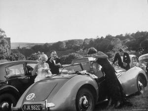 Couples Enjoying Food During Intermission of the Opera at the Glyndebourne Festival by Cornell Capa