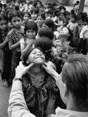Dr. Nevin S. Scrimshaw of the Central American Institute of Nutrition Examining Children for Goiter by Cornell Capa
