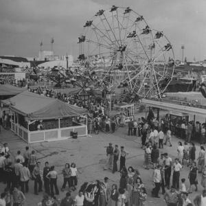 Families Enjoying the Texas State Fair by Cornell Capa