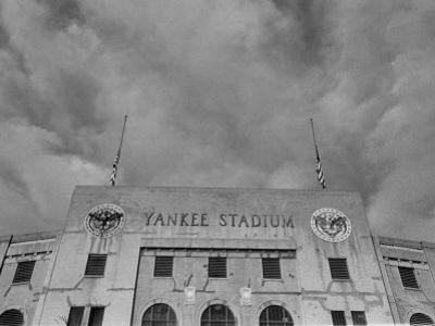 Flags Flying at Half Mast on Top of Yankee Stadium to Honor Late Baseball Player Babe Ruth by Cornell Capa