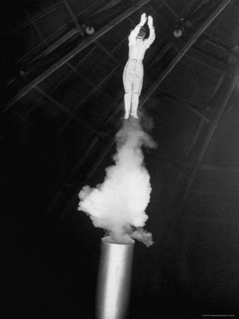 Human Cannonball Egle Zacchini Emerging From Barrel of Cannon During Her Circus Act by Cornell Capa