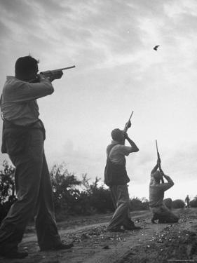 Men Hunting Doves by Cornell Capa