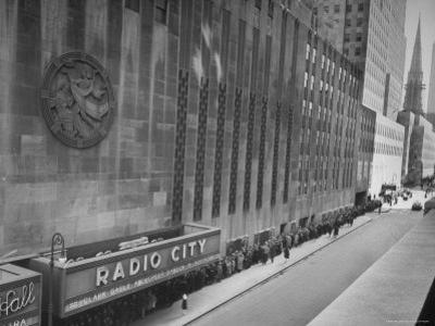 """People at Radio City Music Hall Waiting to See Greer Garson and Clark Gable in """"Adventure"""" by Cornell Capa"""