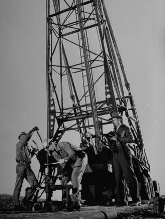Phillips Petroleum Company Employees, Members of the Phillips 66 Champion Amateur Team, Working by Cornell Capa