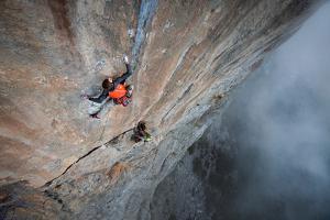 A man climbing a steep limestone face in the Crimea region of Ukraine. by Cory Richards