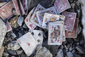 A weathered deck of playing cards at Everest's Base Camp. by Cory Richards