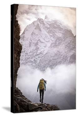 A Woman Climbing in the Khumbu Region of the Himalaya Mountains by Cory Richards