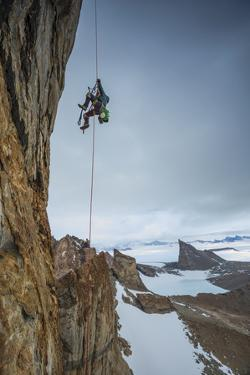 An expedition team member hauls himself up Bertha's Tower in remote Queen Maud Land. by Cory Richards