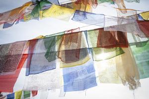 Buddhist Prayer Flags Hang From the Bodhnath Stupa by Cory Richards