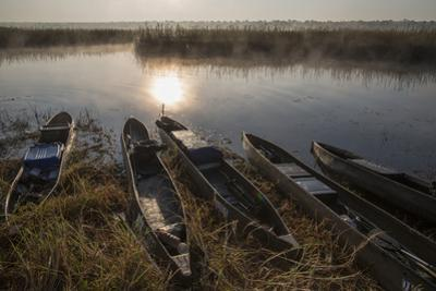 Subsistence Fishermen's Boats on the Cuito River by Cory Richards