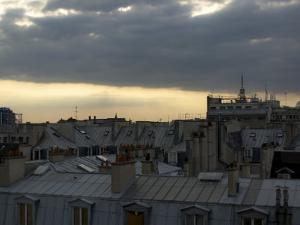 Summer Thunderstorm Rolls over the Rooftops of Paris by Cotton Coulson